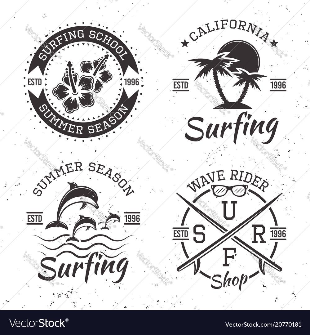 Surfing set of four black vintage emblems