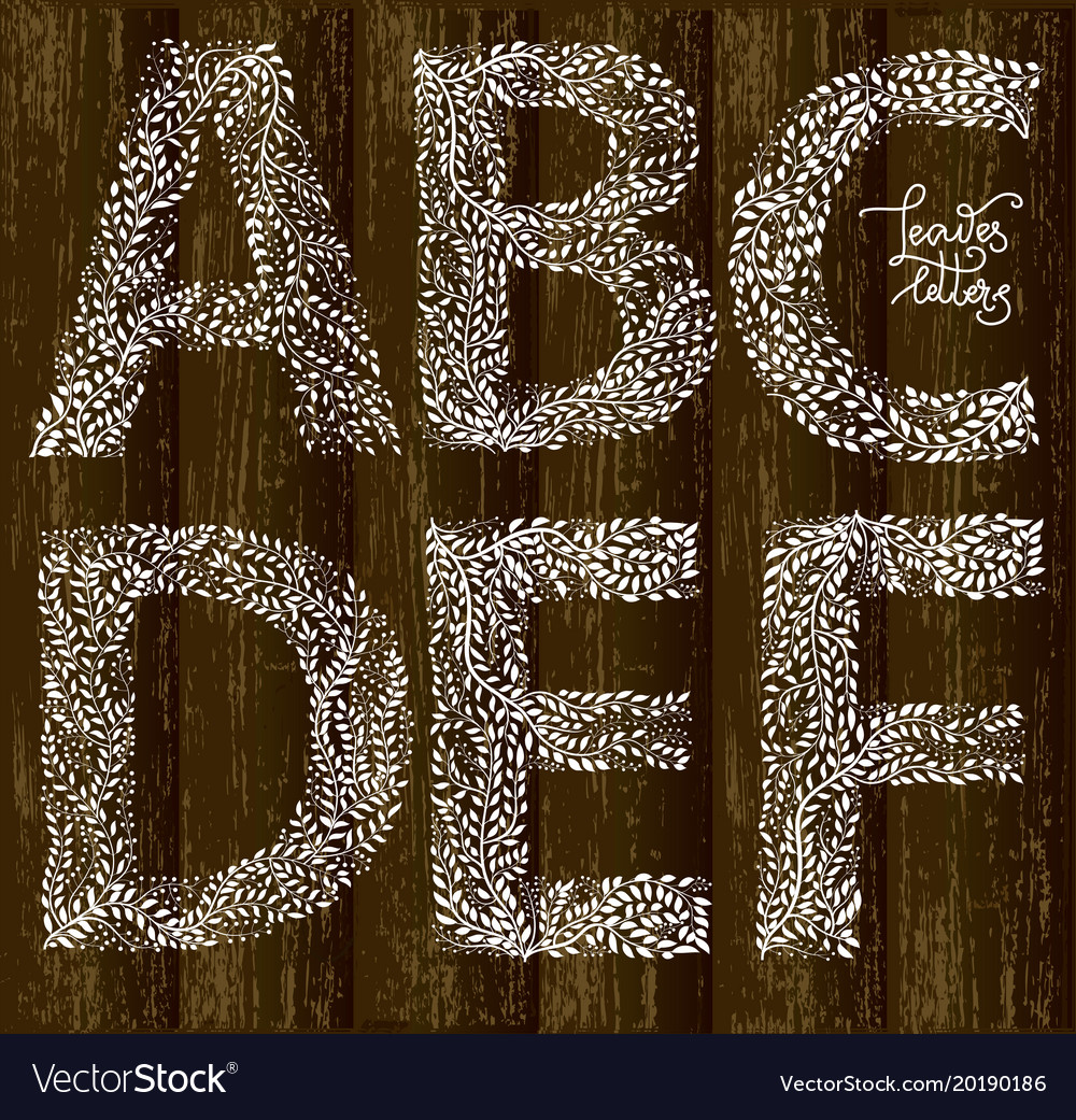Set of letters on wooden background vector image
