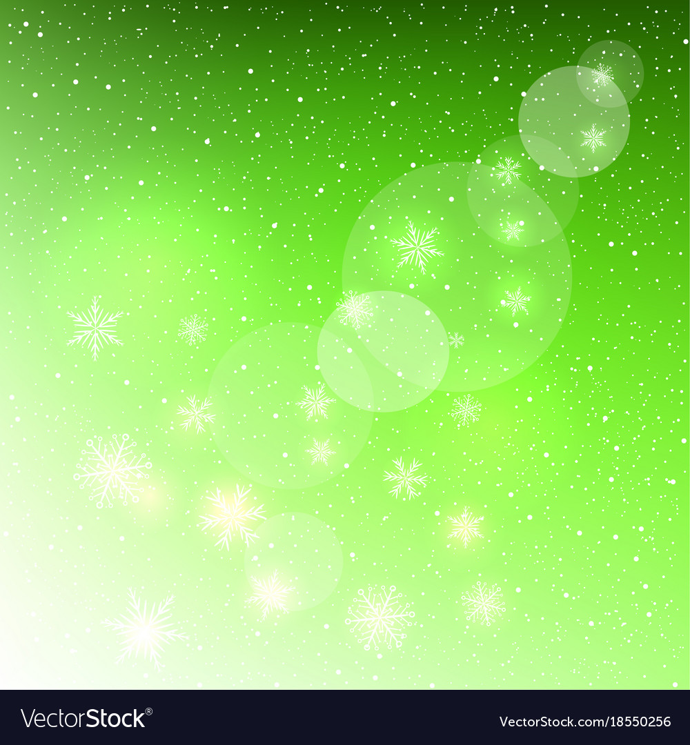 Glowing snowflakes on green background