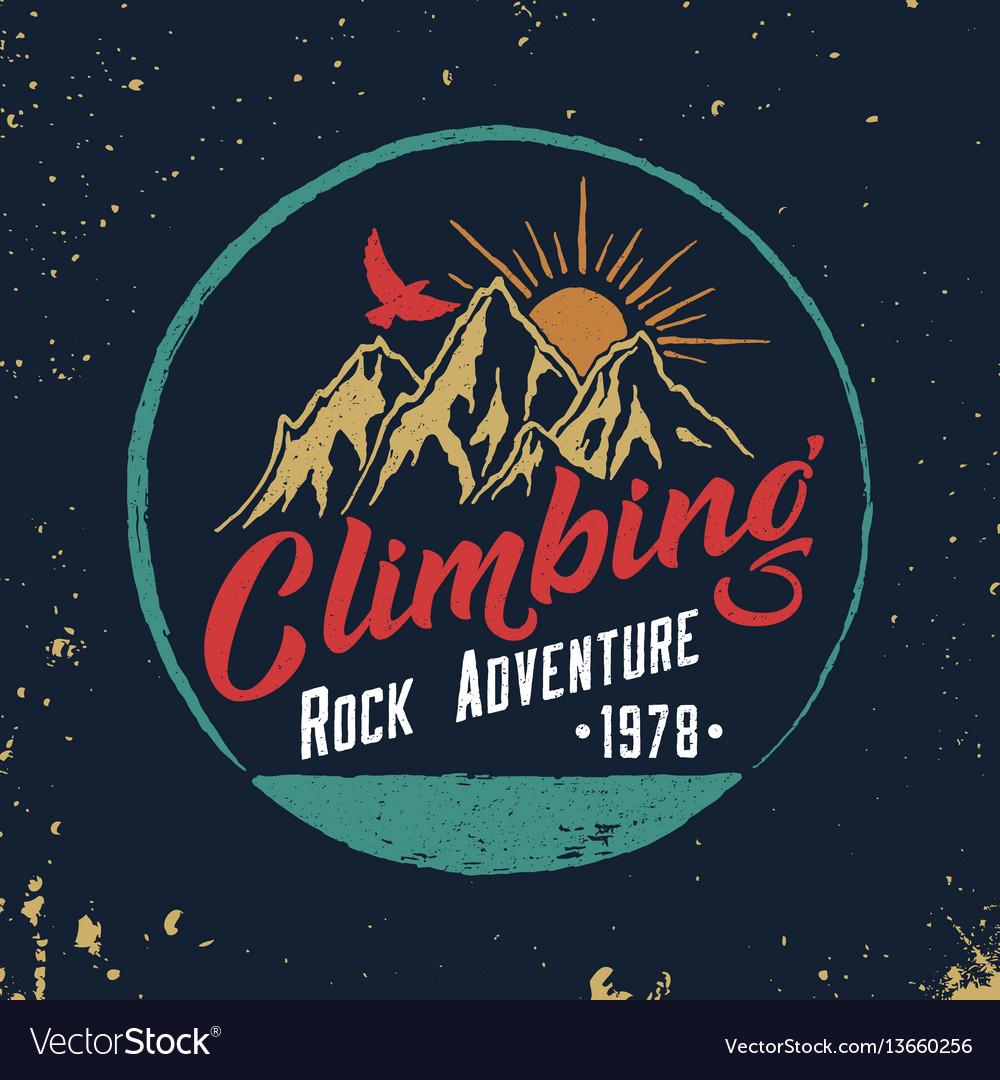 Mountain climbing hand drawn emblem