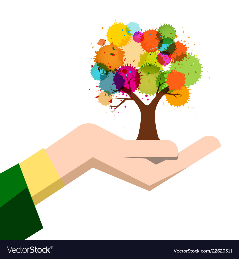 Autumn colorful tree in human hand isolated on