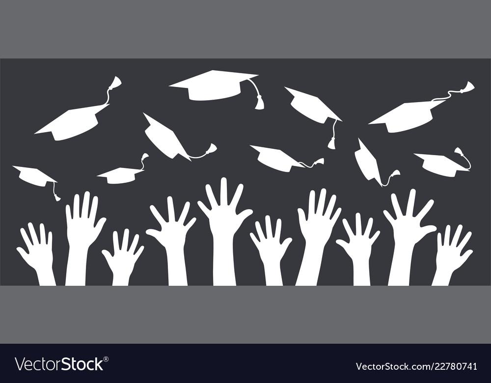Hands of graduates throwing graduation hats in