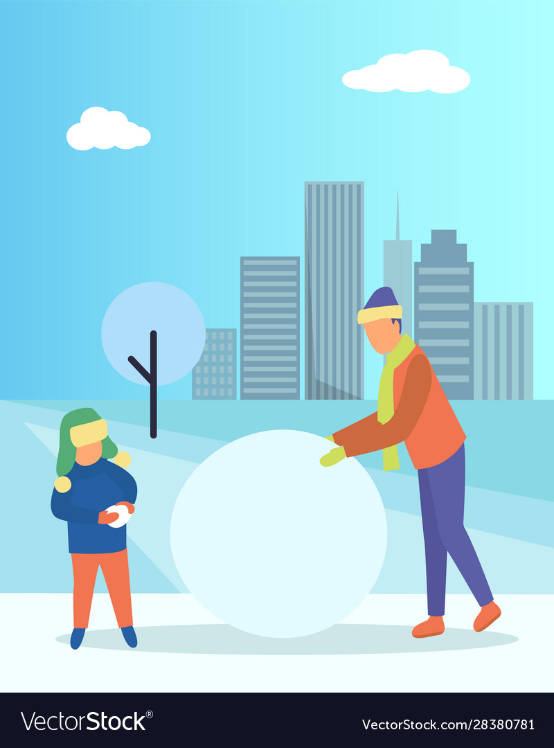 Father and kid making snowman in winter urban park