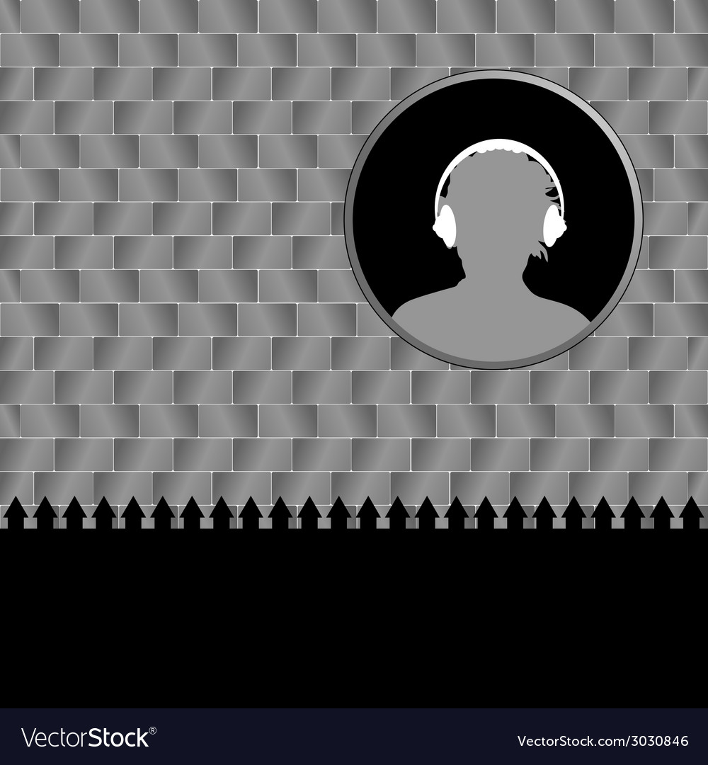 Man with headphones and brick wall