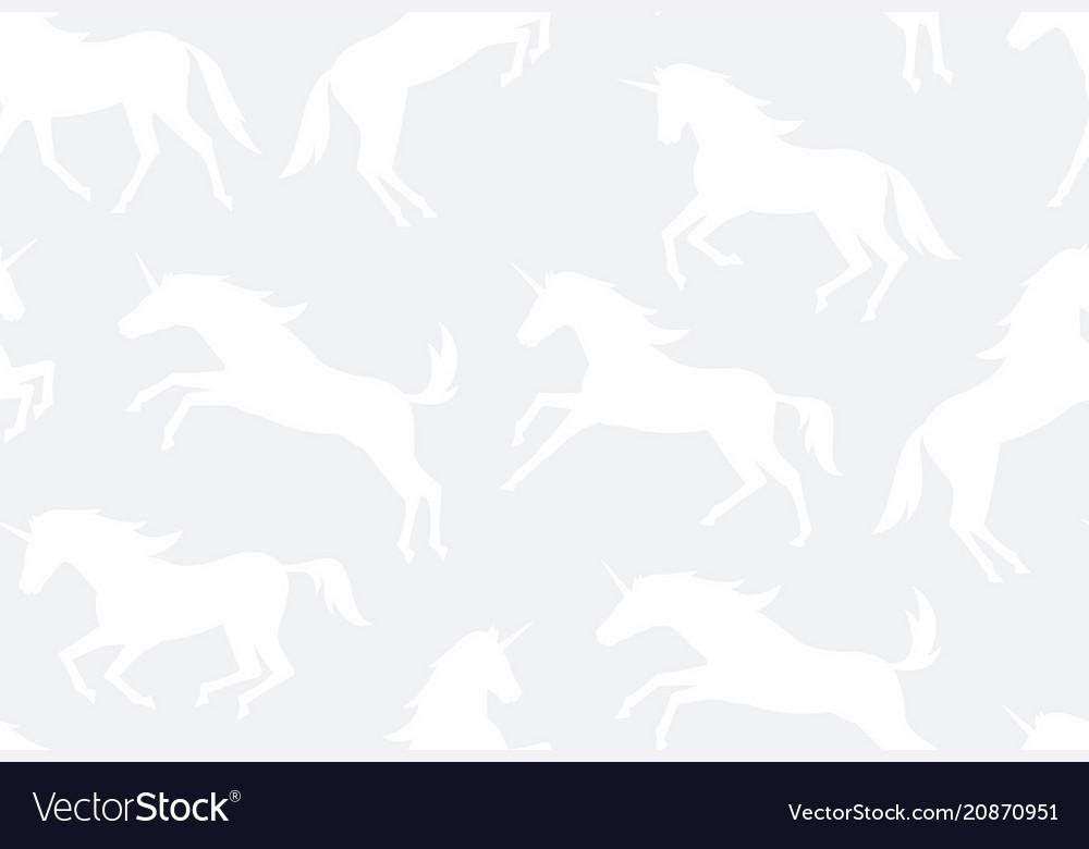 Seamless pattern with white unicorns silhouettes