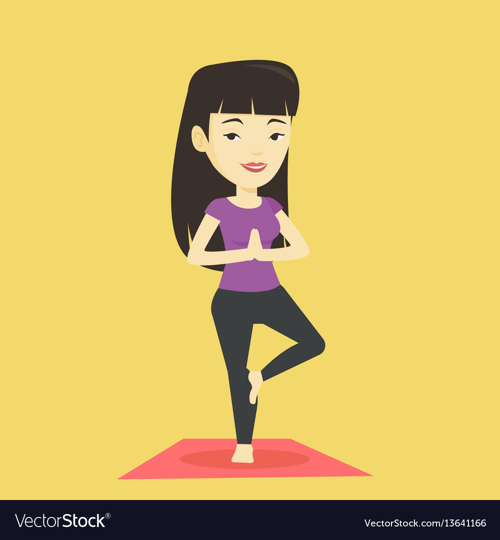 Young woman practicing yoga tree pose