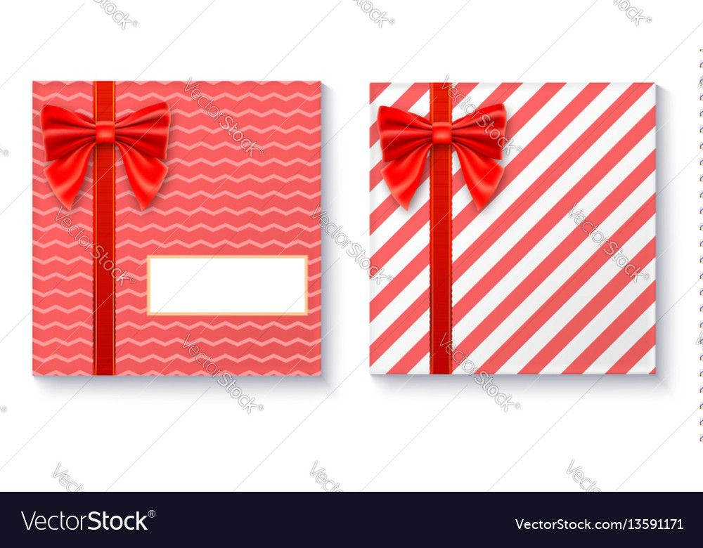 Gift boxes with big red bow and ribbon on white