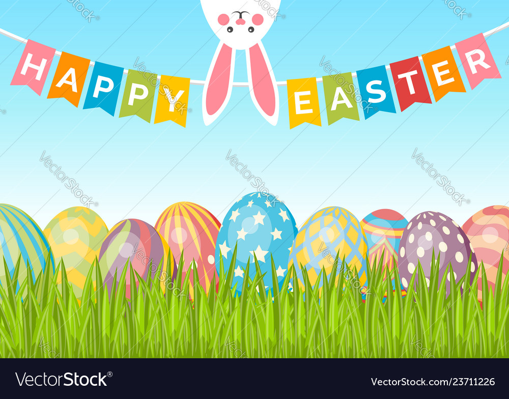 Easter background with eggs on green grass bunny