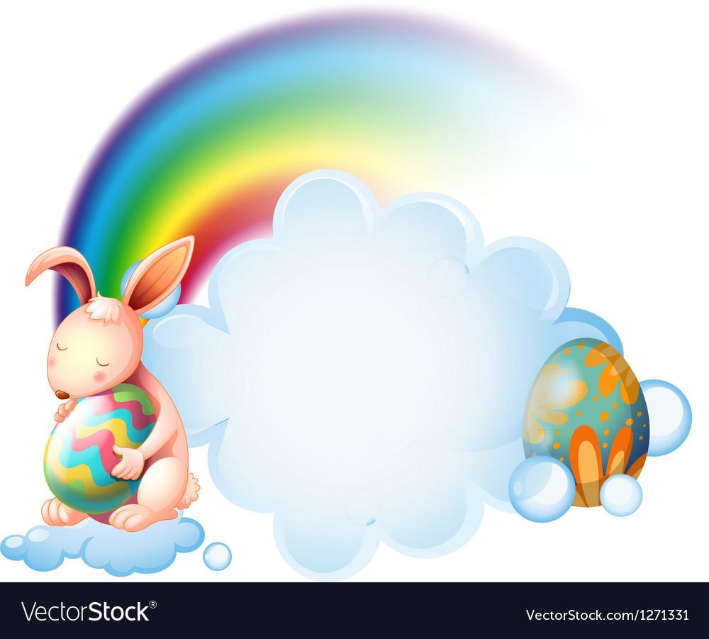 A bunny hugging an easter egg near the rainbow