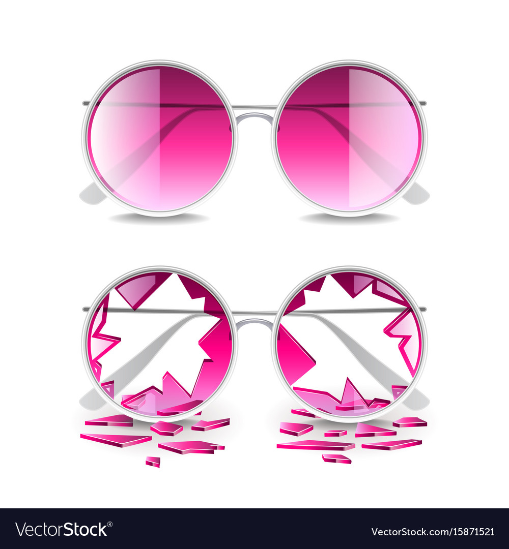 Broken pink glasses isolated on white