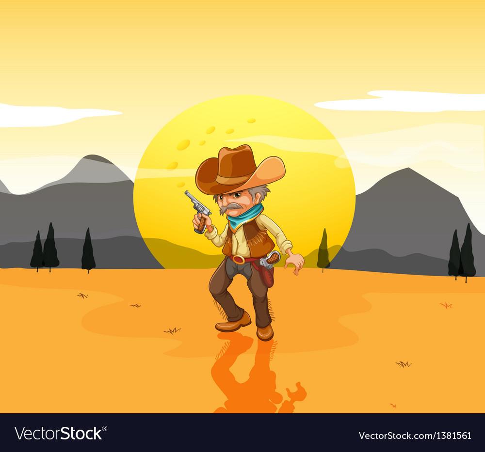A desert with an armed cowboy