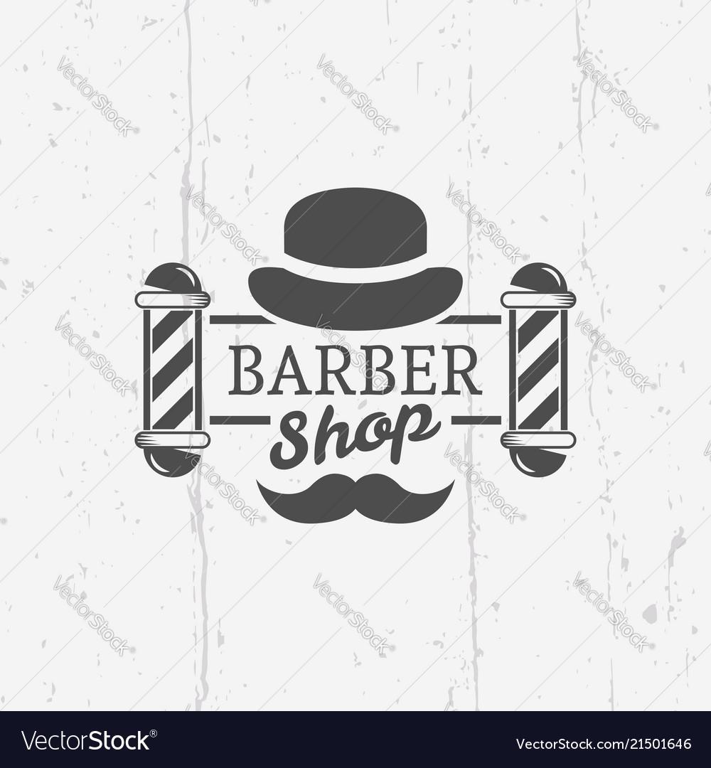 Barber shop pole with gentleman hat emblem