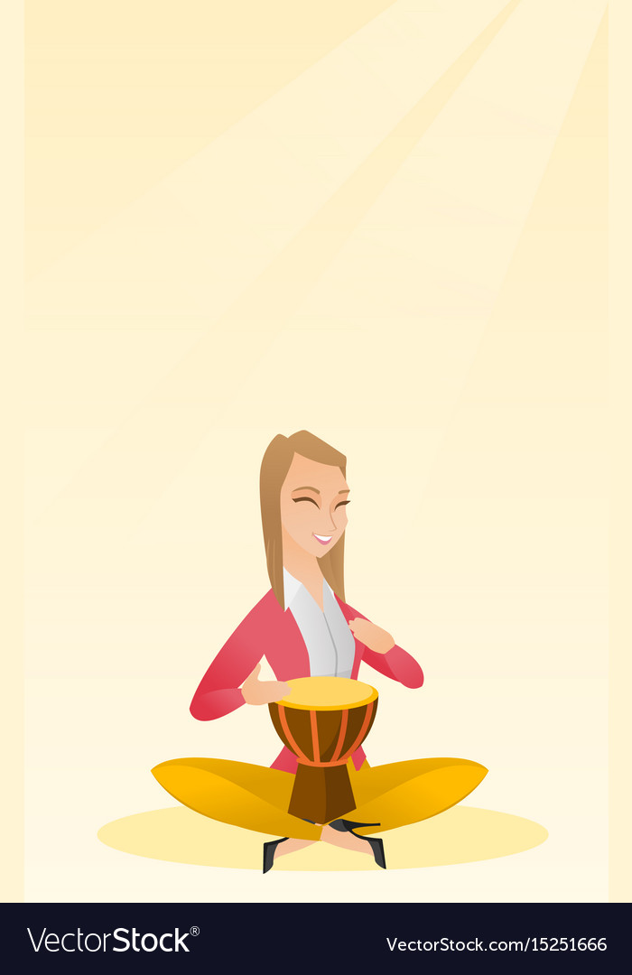 Woman playing the ethnic drum