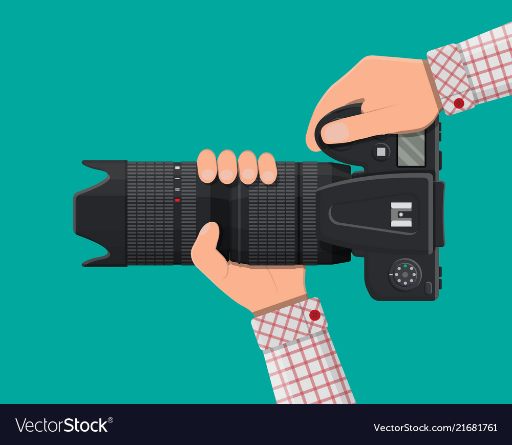 Modern photo camera in hand