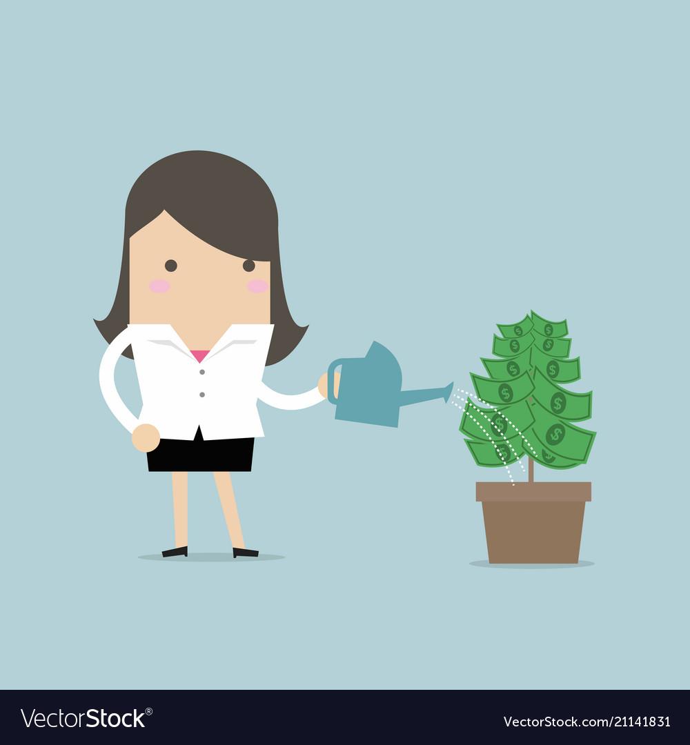 Businesswoman watering money plant