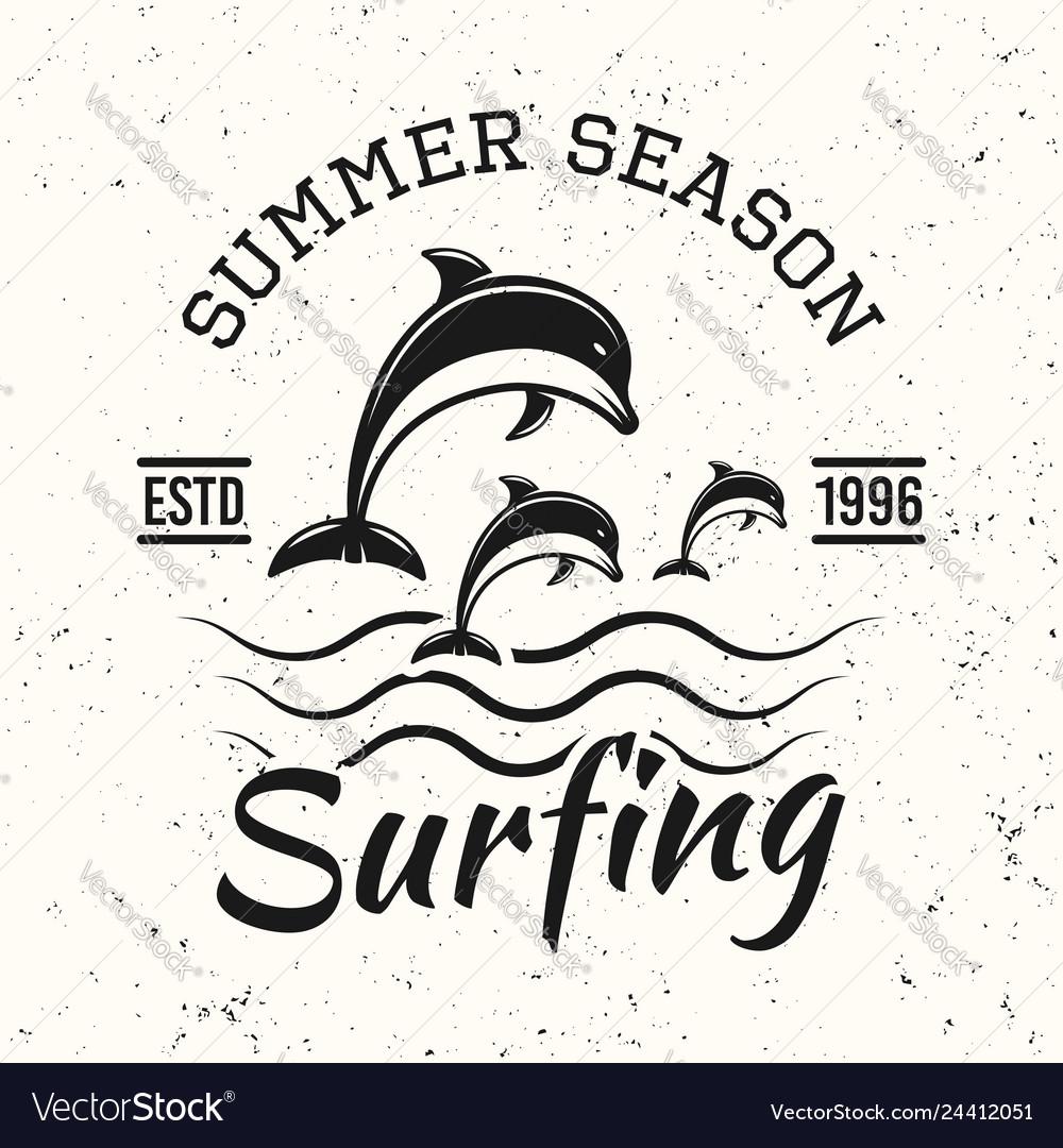 Surfing black vintage emblem with dolphins
