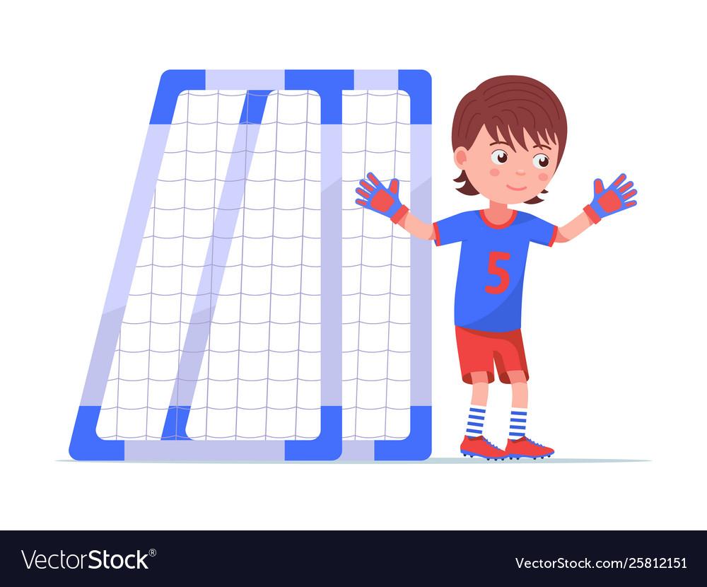 Boy goalkeeper stands next to football goal