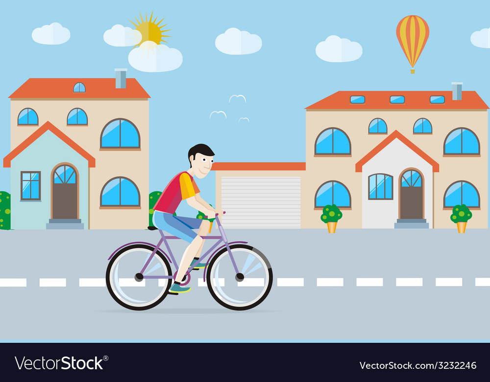 Man riding his bike on the road among buildings