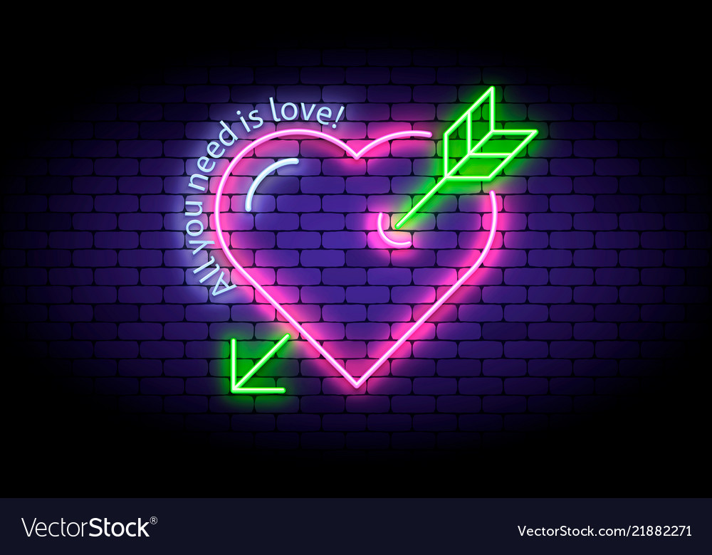 Neon heart with arrow on the wall