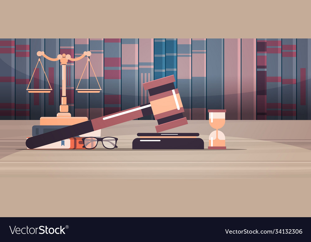 Gavel scales and judge book on wooden table legal