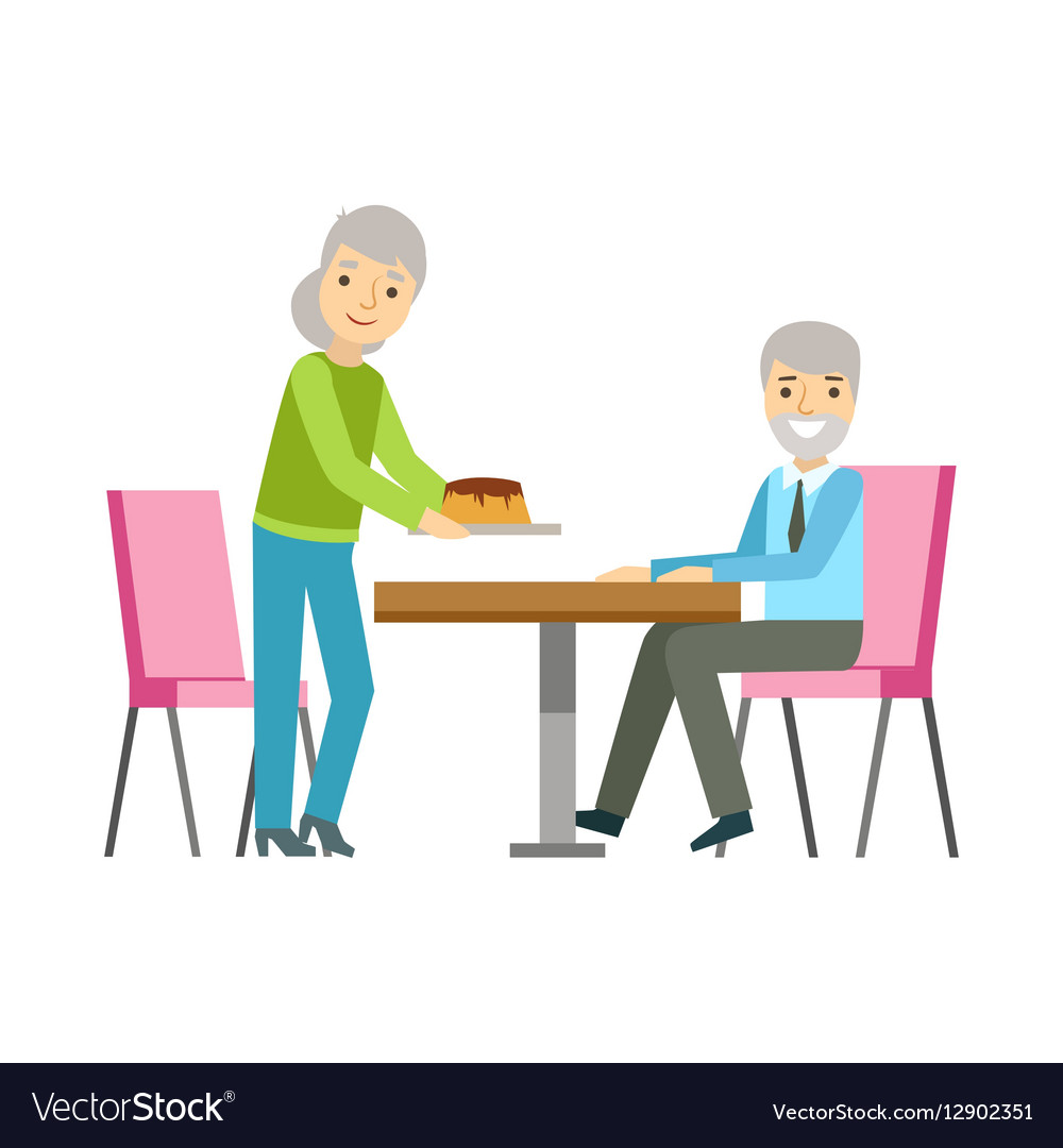 Old Couple Eating Cake At The Table Smiling