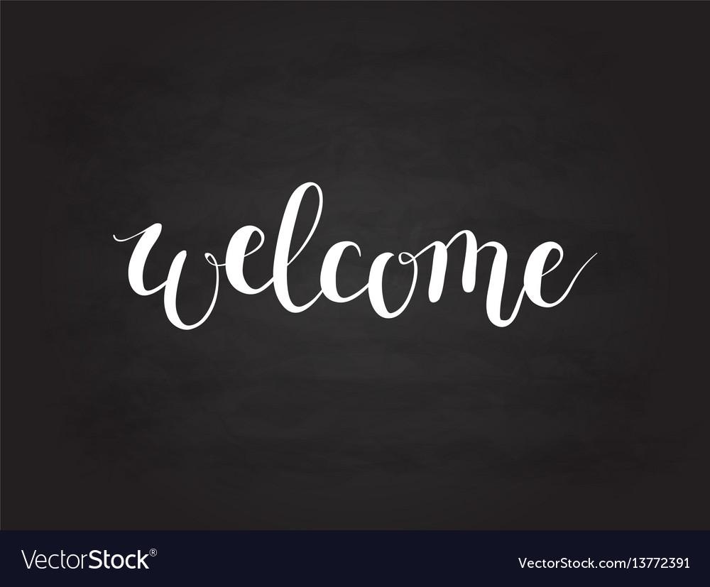 Calligraphy welcome word on blackboard