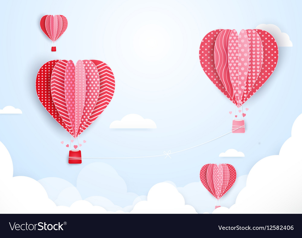 Hot air balloons in shape of heart flying