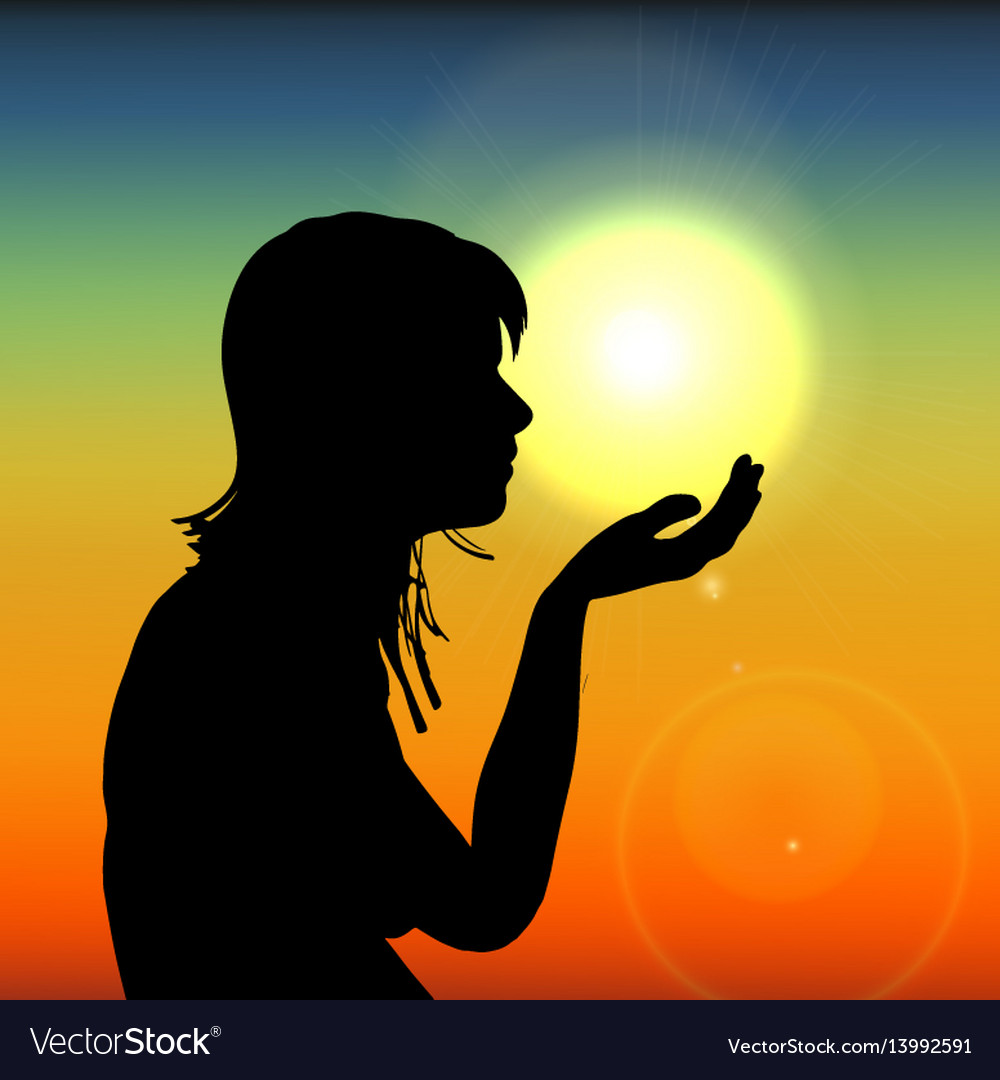 Silhouette woman on sunset holding sun in hand on