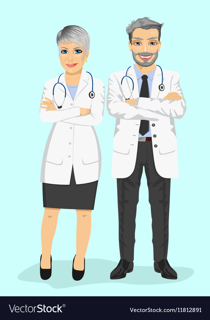 Mature doctors standing with arms folded