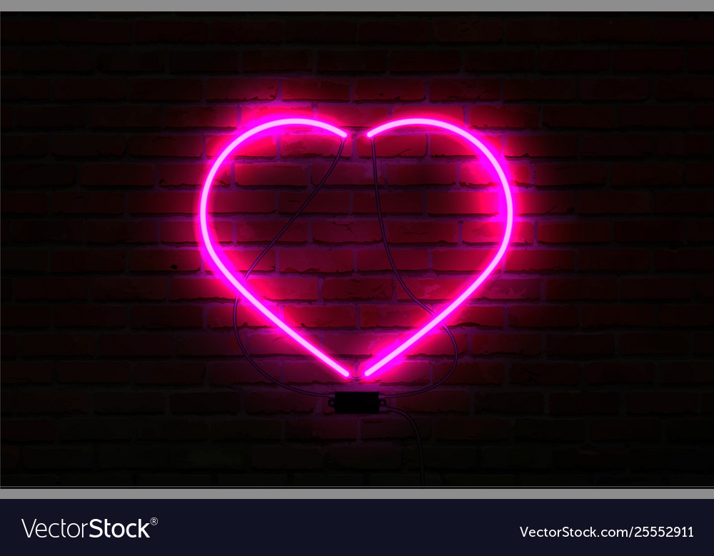 Pink glowing neon heart on brick wall background