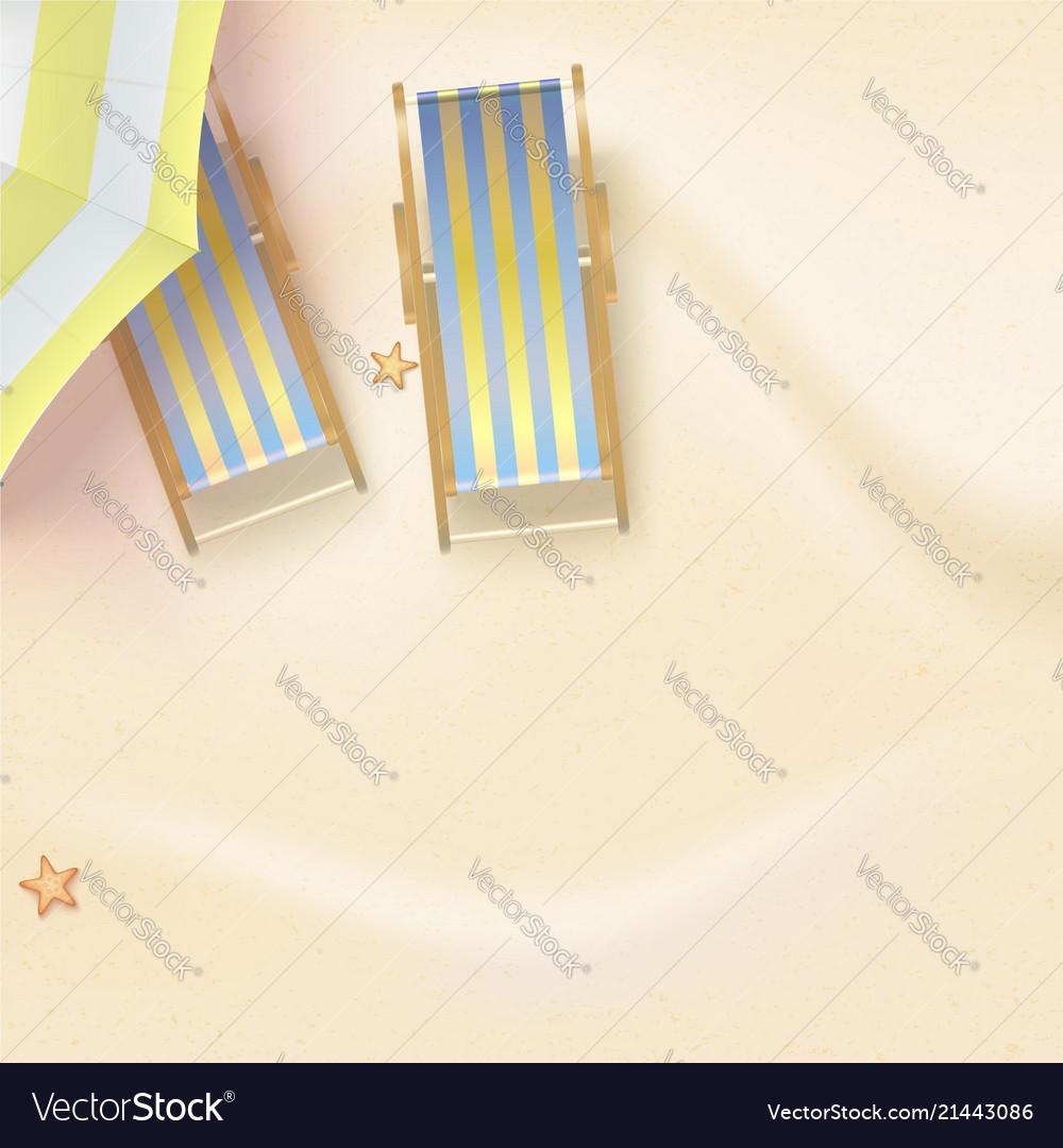 Sun loungers under sun parasol on the sandy beach