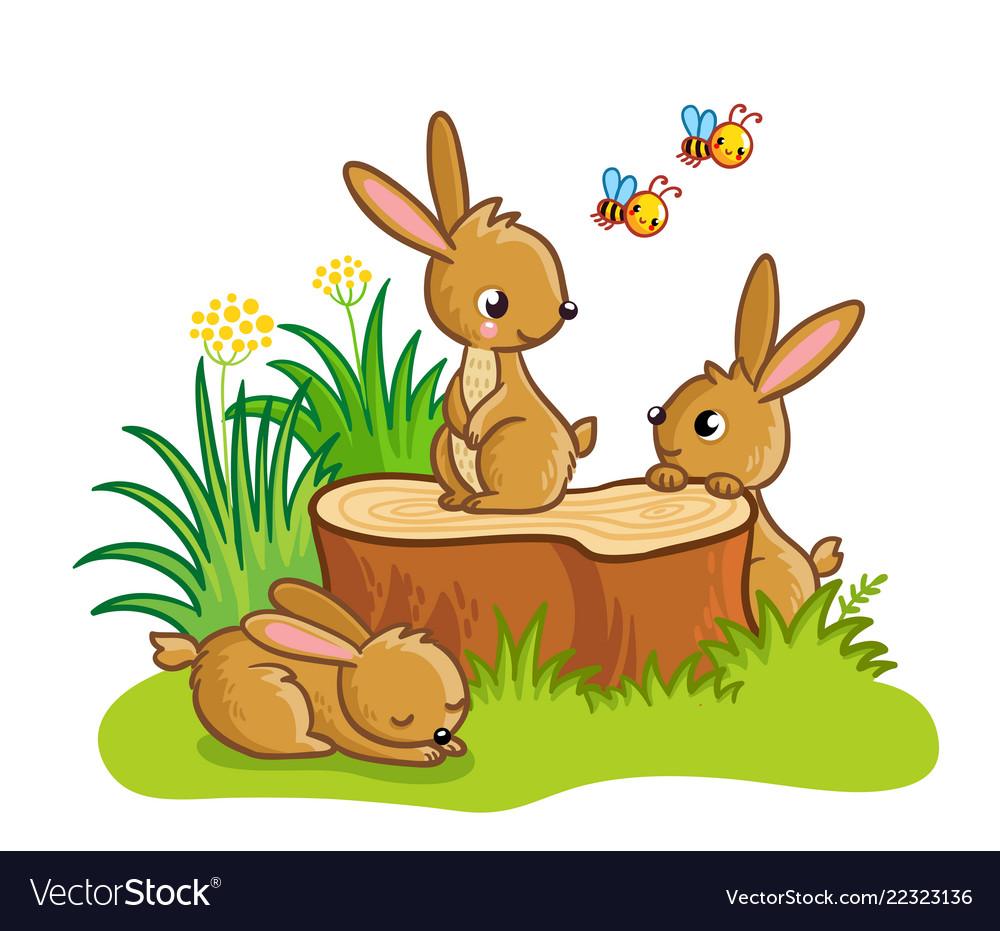Cute rabbits sitting around the stump