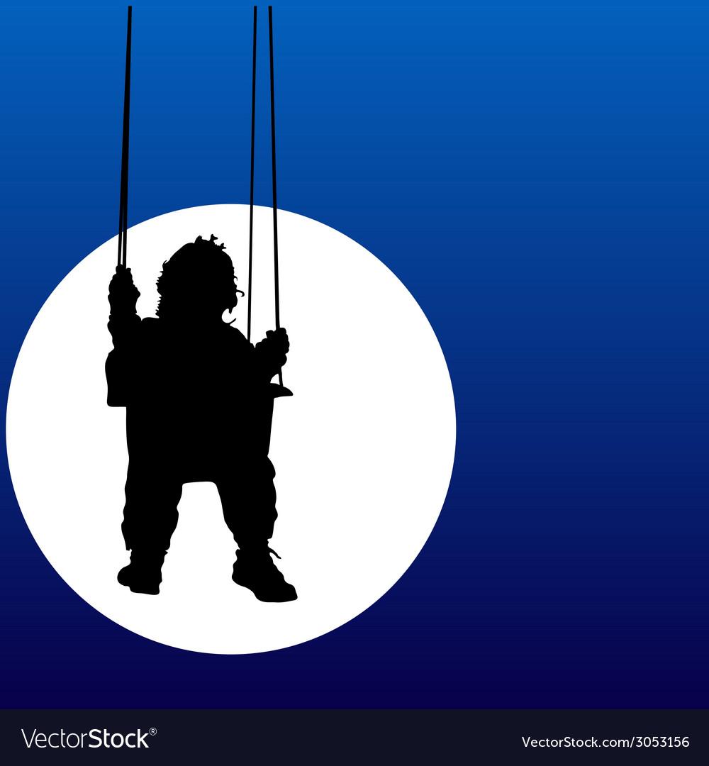 Baby swings on a swing in the moonlight