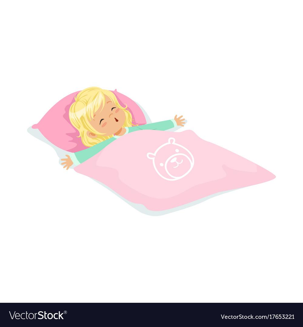 Sweet blonde little girl sleeping on her bed