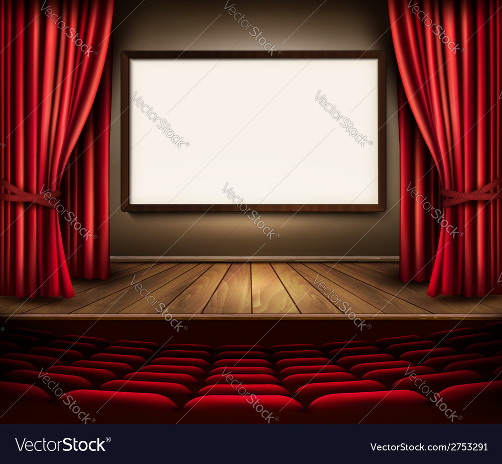 A theater stage with a red curtain seats and a