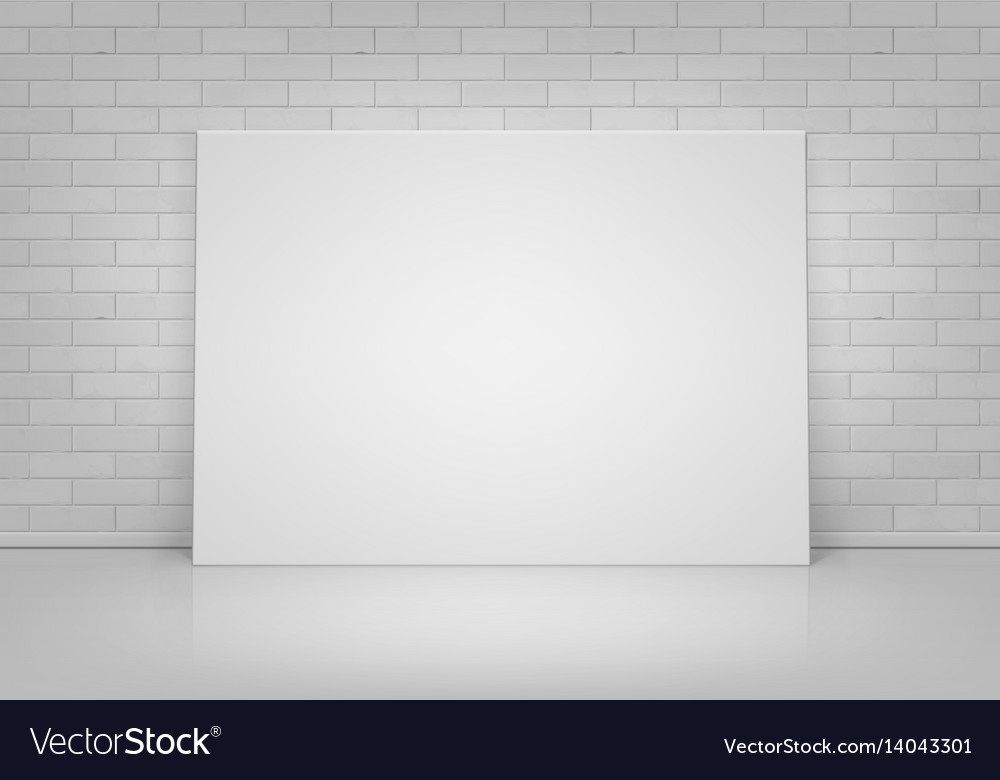 White picture frame standing with brick wall