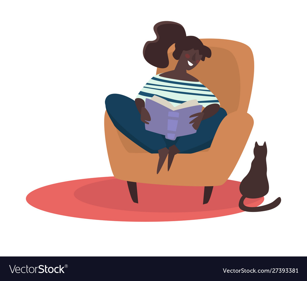 Girl reading book in armchair cat sitting on