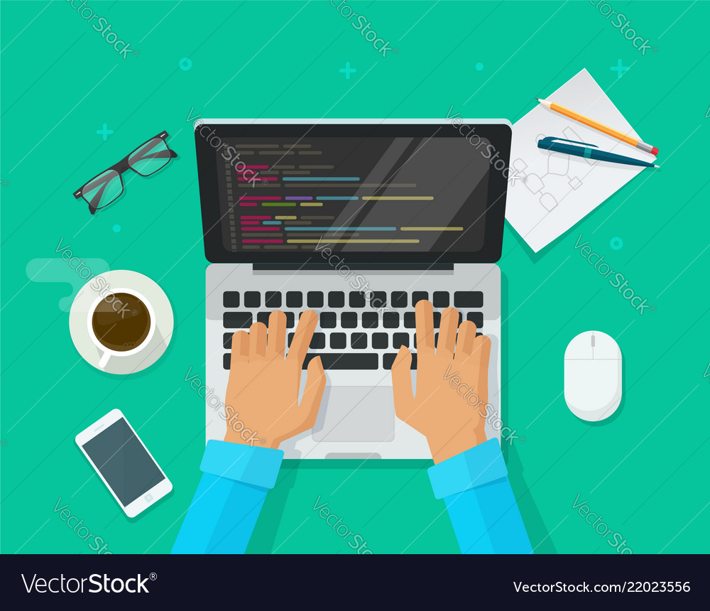 Programmer coding on laptop computer on work desk