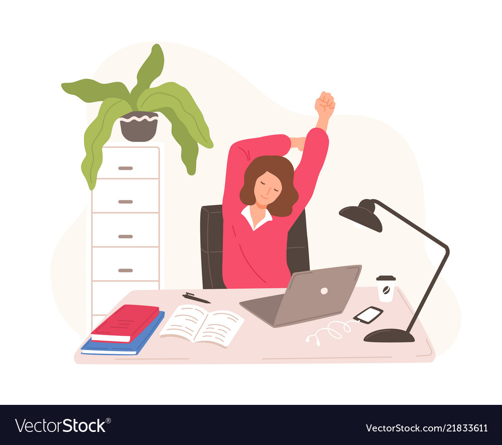Smiling woman sitting at desk with laptop taking
