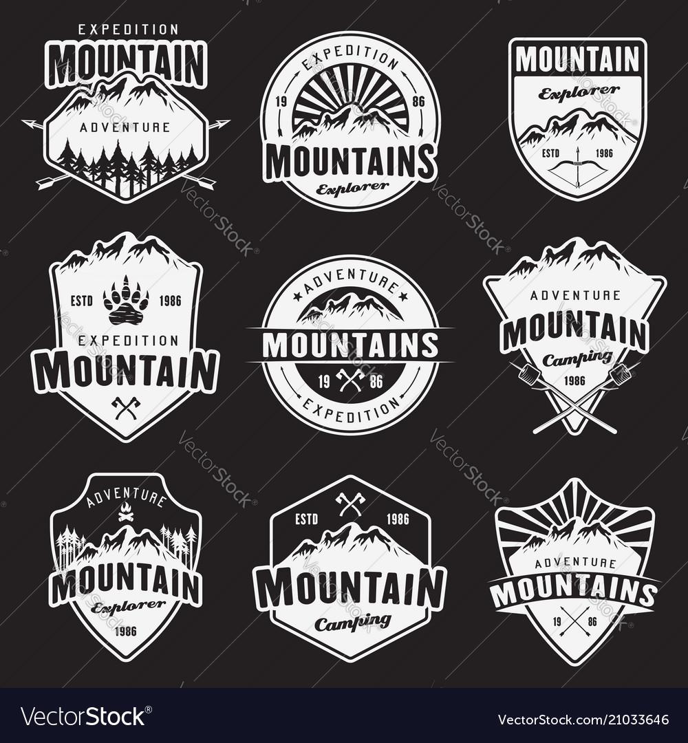 Mountain travel white emblems on dark