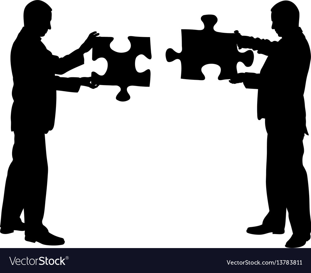 Businessmen holding puzzle pieces