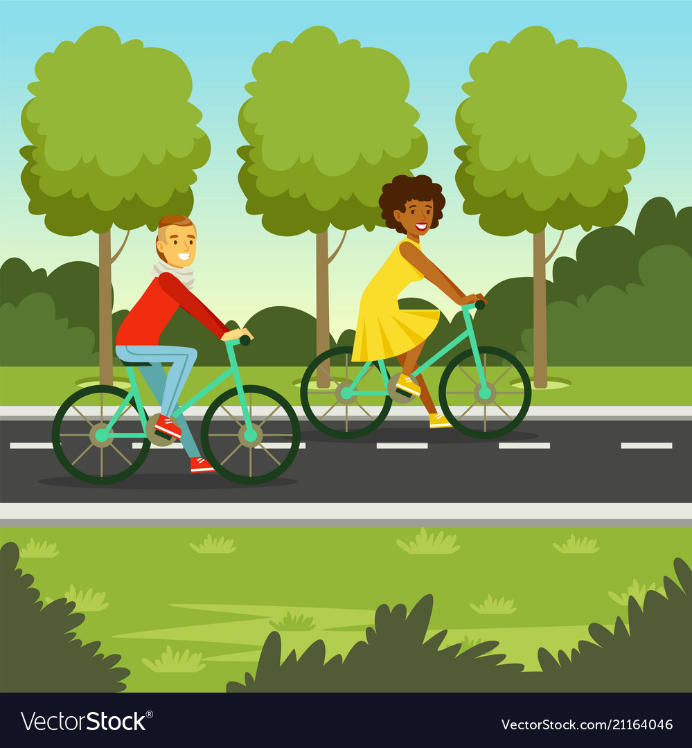 Young man and woman riding bicycle in the park