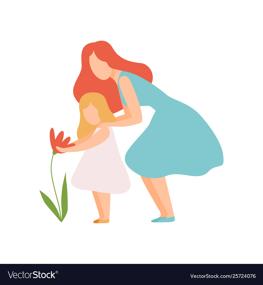 Mother and daughter looking at beautiful flower
