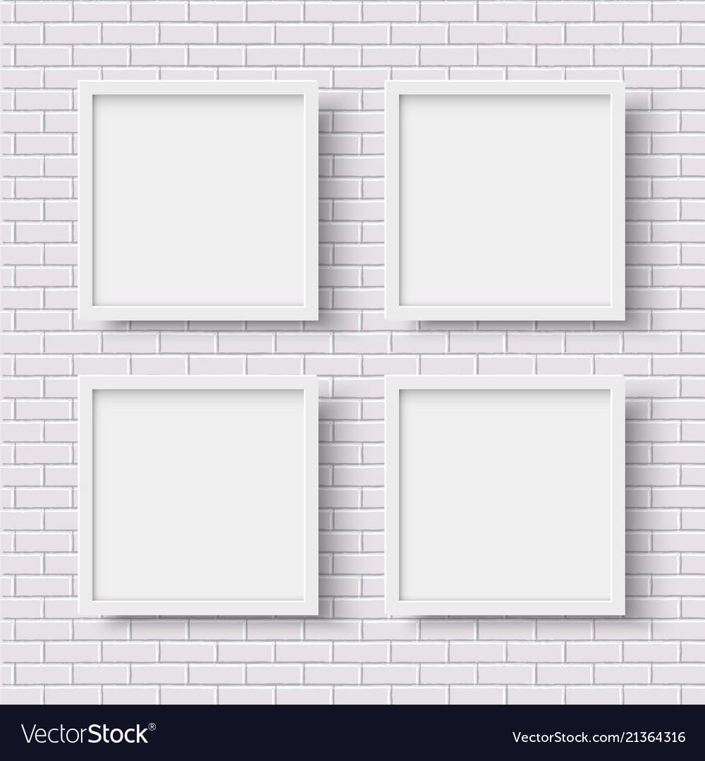 Four white square empty frames on white brick wall