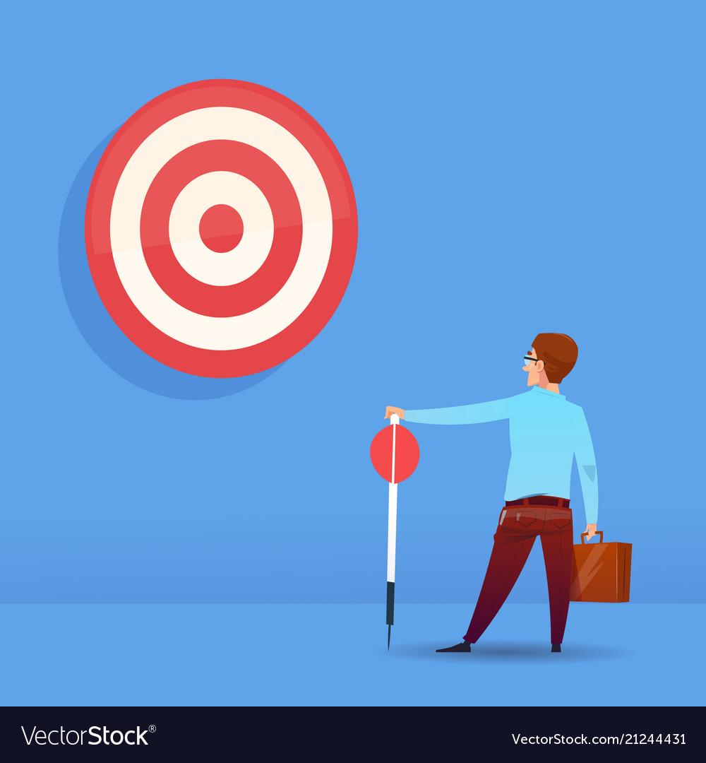 Rear view businessman holding arrow target