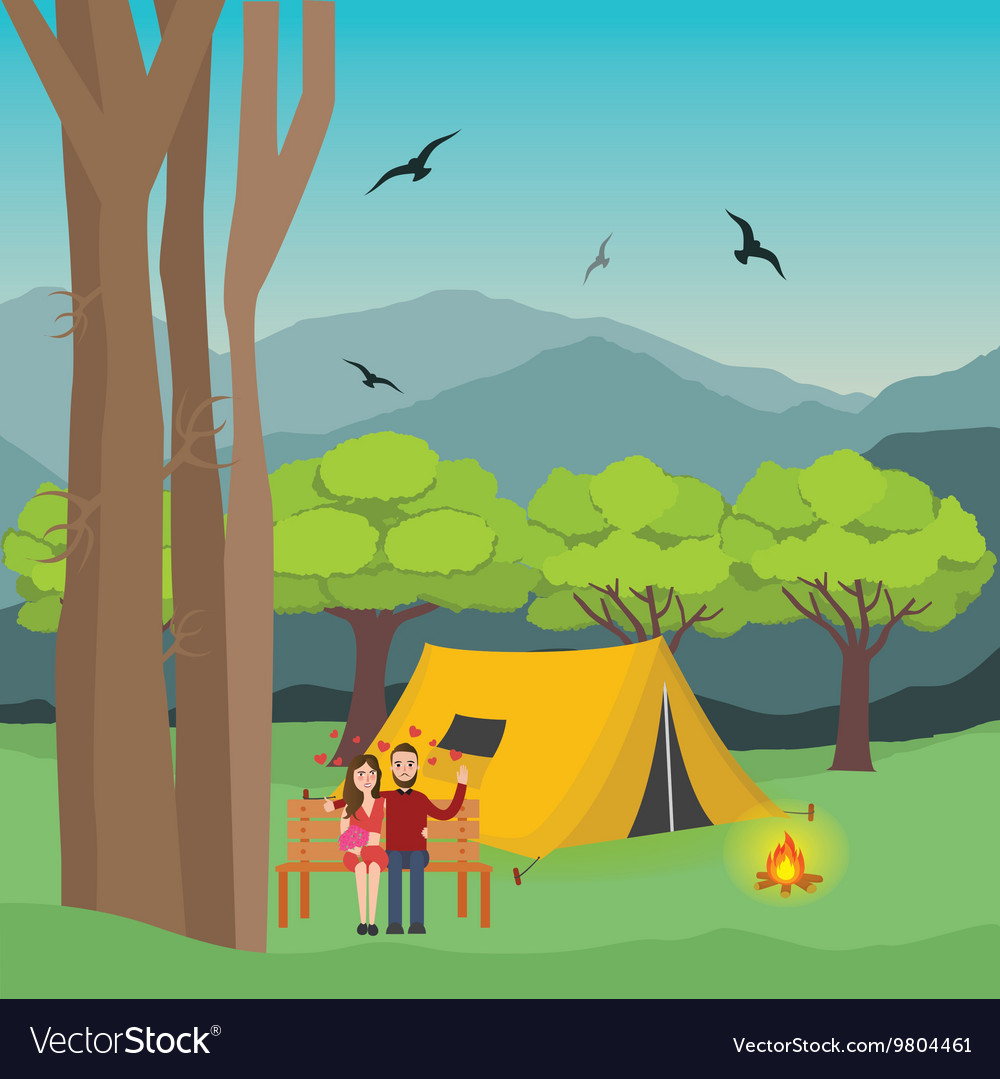Couple camping in forest man and woman with fire