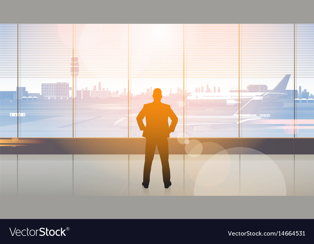 Silhouette Man Waiting For Arrival In Airport Hall