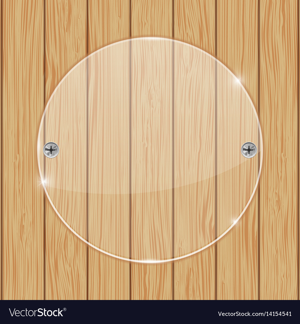 Round glass plate on wooden background