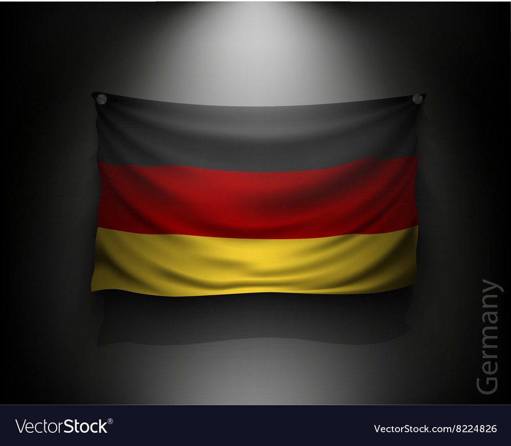 Waving flag germany on a dark wall