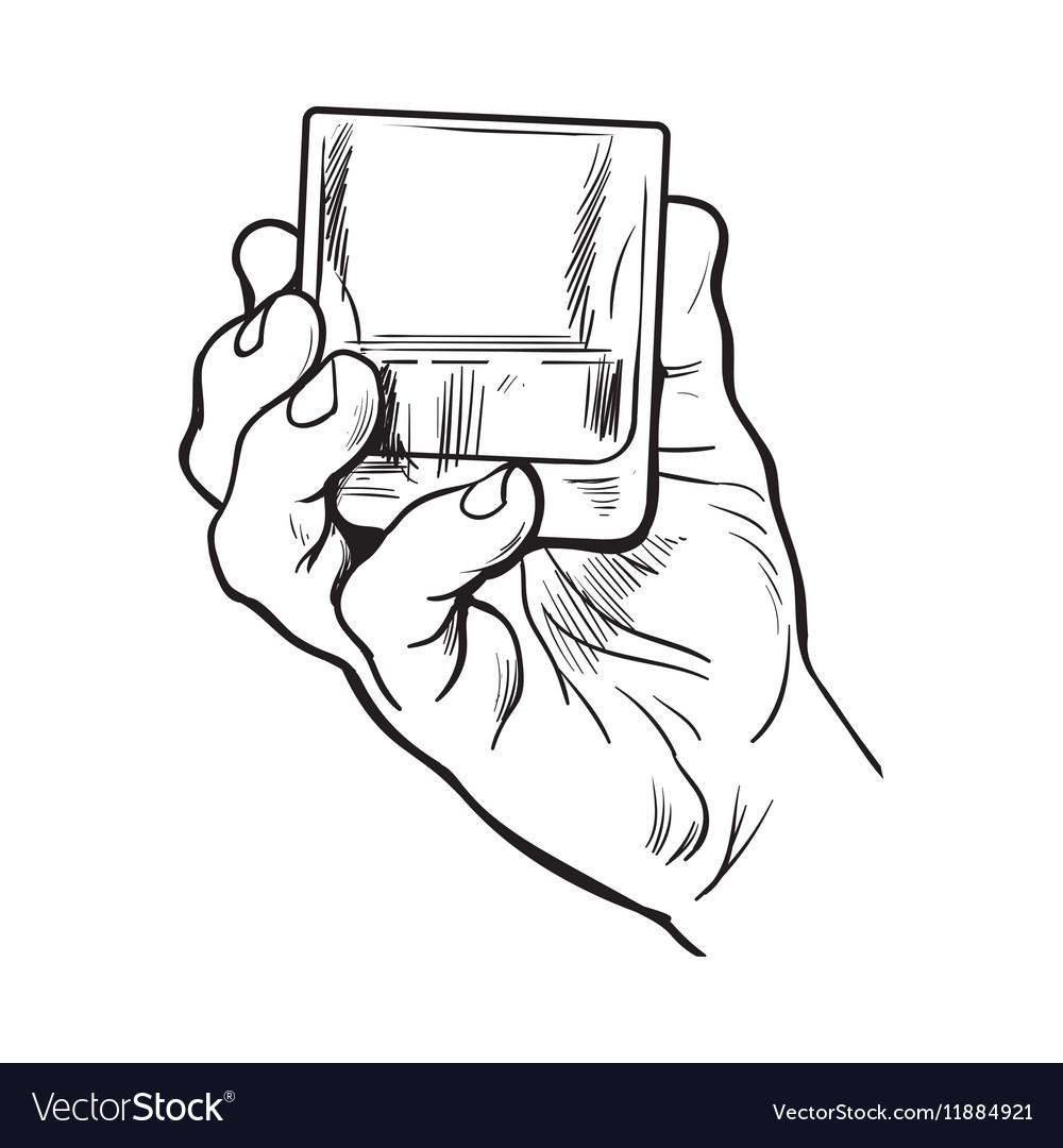 Hand holding full glass of whiskey